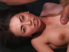 Brunette hottie plays with 2 cocks