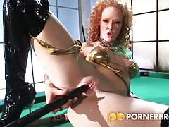 Redheaded milf toys her asshole