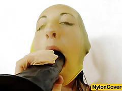 Young girl covered in nylons rides a black dildo