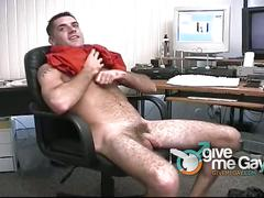Horny and hairy stud wanking his big cock at work