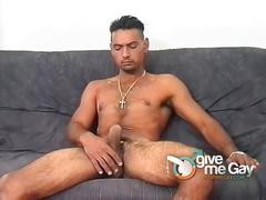 Handsome stud jerking his huge cock in solo.