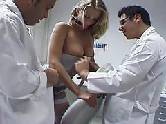 Sexy blonde patient gets examined by two doctors