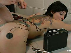 Blonde mistress wires her submissive brunette