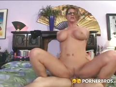 Busty mom fucked on bed by a much younger stud.