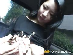 Sexy asian babe showing her tits in the car.
