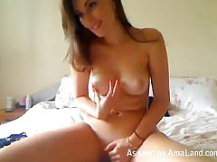 Naked horny hottie toying with her twat