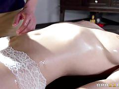 Busty brunette babe gets massaged and fucked hard.