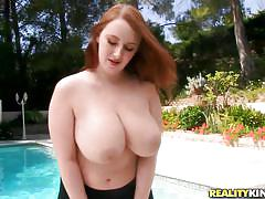 Redhead with big natural tits