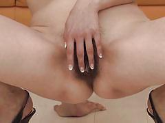 Japanese milf shoves dildo in pussy
