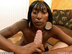 Ebony slut deepthroating a huge white cock