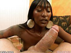 Ebony slut deepthroating a huge white cock