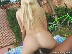 Lovely blonde belle rides a hard black cock