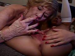 Grannny teases a young chick's pussy