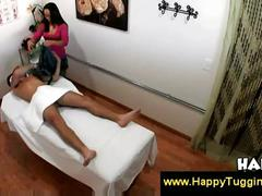 Asian hottie gives handjob at a salon