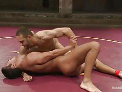 Naked muscled wrestlers fight and fuck