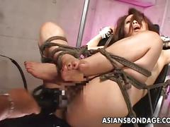 Tied up asian penetrated with fucking machines