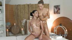 Oiled lesbians on massage table european fingering