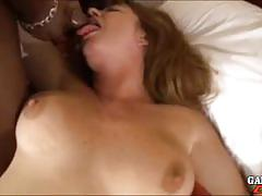 Sexy brunette sucks a hard rod of black meat