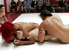 Three buff girls wrestle