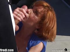 Sexy redhead in black stockings gets banged hard