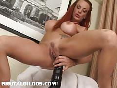 Redhead chick shannon riding a gigantic dildo