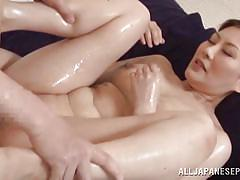 Oiled brunette gets filled up with cum