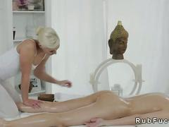 Hot lesbians fingering on massage table