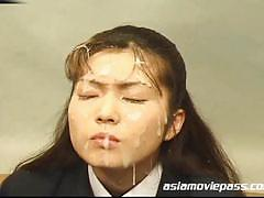 Japanese schoolgirl enjoys bukkake with pleasure