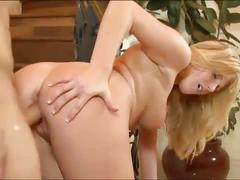 Hot blonde gets her cunt fucked by the stairs