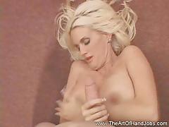 Busty blonde milf gives a great pov handjob