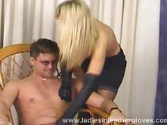 Blonde mistress plays with her slave
