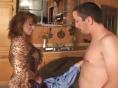 Sexy milf takes on a hard young cock