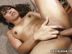 Asian milf hops on a big hard cock