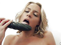 Freaky blonde plays with her big dildos