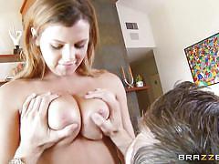 Sexy babe titfucks her man