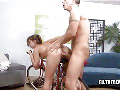 Brunette with pigtails fucked on bike