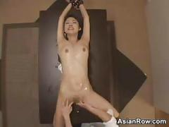 Cuffed asian has her pussy played with