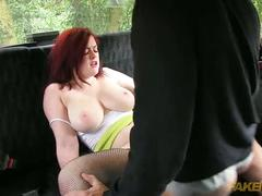 Cute redhead with pink puffy pussy fucked in fake taxi
