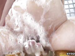 Foam on her big boobs