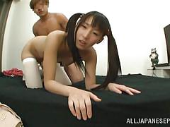 Japanese girl with ponytails sucks a cock