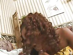 Curvy black chick sucks a cock