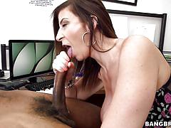 Big breasted milf sucks on black balls in the office