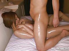 Oiled up busty nippon receives a cock