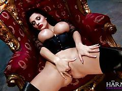 Devilish brunette plays with her sex slave