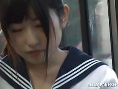 Japanese schoolgirl sucks cock in alley