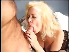 Busty blond mom fucks with two guys