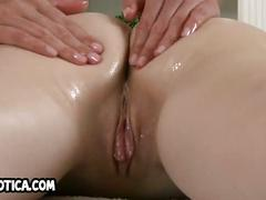 Sexy brunette lesbian babe gets an oily massage