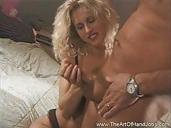 Handjob by a big titted blonde milf babe!