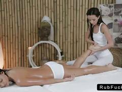 Masseuse massages hot body of brunette babe