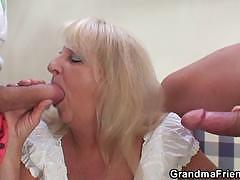 Mature blonde slut gets banged hard by two studs